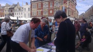 Julian Huppert MP signs petition at joint Cambridge Amnesty/Cambridge WDM action against torture, 26 June 2014.  Picture Clare Baker