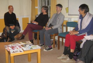 Nick Dearden with three Oxford WDM activists sitting down