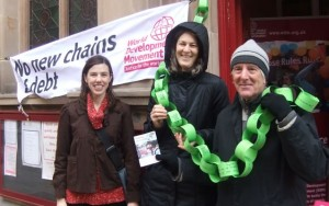 No new chains of debt: photo of campaigners draped with paper chain